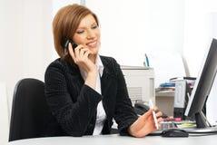 Donna di affari con il calcolatore Fotografia Stock