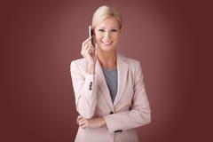 Donna di affari con il cellulare Immagini Stock