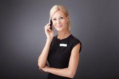 Donna di affari con il cellulare Fotografia Stock