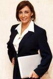 Donna di affari con il computer Fotografia Stock