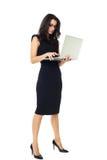 Donna di affari con il computer portatile Immagini Stock