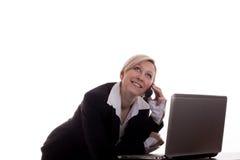 Donna di affari con il computer portatile ed il telefono Fotografia Stock