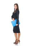 Donna di affari con il dispositivo di piegatura blu Fotografia Stock Libera da Diritti