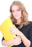 Donna di affari con il dispositivo di piegatura giallo Fotografia Stock Libera da Diritti
