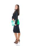 Donna di affari con il dispositivo di piegatura verde Fotografie Stock Libere da Diritti
