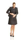 Donna di affari con il forte mal di stomaco Fotografie Stock