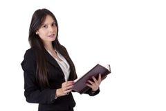 Donna di affari con il libro Immagini Stock
