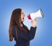 Donna di affari con il megafono Immagini Stock Libere da Diritti