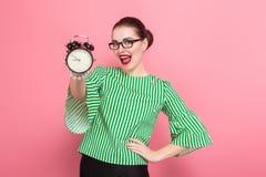 Donna di affari con il panino e gli orologi dei capelli immagini stock