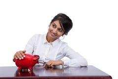 Donna di affari con il porcellino salvadanaio Fotografie Stock