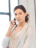 Donna di affari con il telefono delle cellule Fotografie Stock