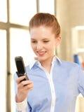 Donna di affari con il telefono delle cellule Immagini Stock