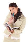 Donna di affari con il telefono ed il diario delle cellule immagini stock