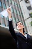 Donna di affari con l'aereo di carta Fotografia Stock Libera da Diritti