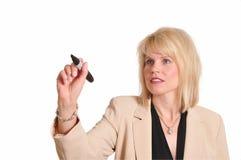 Donna di affari con l'indicatore Fotografia Stock