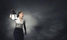 Donna di affari con la lanterna Fotografie Stock