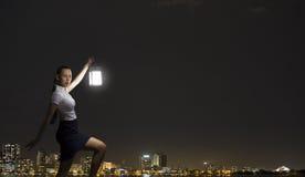Donna di affari con la lanterna Fotografia Stock