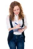 Donna di affari con la penna e compressa per le note Fotografia Stock