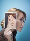Donna di affari con le grandi orecchie Immagini Stock Libere da Diritti