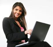Donna di affari con un calcolatore fotografie stock