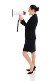 Donna di affari con un megafono Fotografia Stock Libera da Diritti