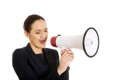 Donna di affari con un megafono Immagine Stock Libera da Diritti