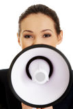 Donna di affari con un megafono Immagine Stock