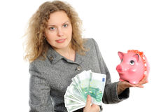 Donna di affari con una banca piggy fotografia stock