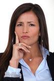 Donna di affari confusa Fotografia Stock Libera da Diritti