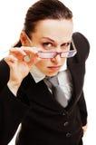 Donna di affari curiosa Immagini Stock