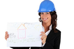 Donna di affari dell'architetto che tiene un'illustrazione Fotografia Stock