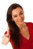 Donna di affari di Besutiful che gesturing successo con la mostra del pollice su Fotografia Stock