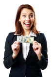 Donna di affari di risata che tiene i dollari americani Fotografia Stock