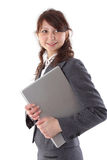 Donna di affari di risata che tiene un computer portatile Fotografia Stock Libera da Diritti