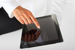 Donna di affari e compressa digitale. Immagine Stock