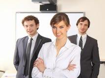 Donna di affari e la sua squadra. Fotografia Stock