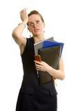 Donna di affari faticosa con i dispositivi di piegatura. Isolato Fotografie Stock