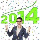 Donna di affari felice che celebra un nuovo anno 2014 Fotografia Stock Libera da Diritti
