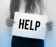 Donna di affari Holding Help su carta Immagini Stock