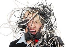 Donna di affari matura che grida in cavi. Fotografia Stock Libera da Diritti