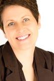 Donna di affari matura sorridente Fotografia Stock