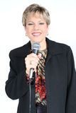 Donna di affari nel nero con il microfono Immagini Stock Libere da Diritti
