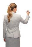Donna di affari o insegnante con l'indicatore dalla parte posteriore Fotografia Stock