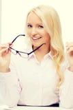 Donna di affari o segretario sorridente in ufficio Fotografia Stock