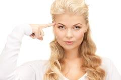 Donna di affari pensierosa sopra bianco Fotografia Stock Libera da Diritti