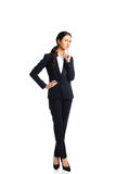 Donna di affari premurosa con un dito sotto il mento Fotografia Stock