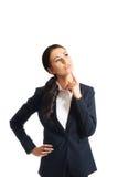 Donna di affari premurosa con un dito sotto il mento Immagine Stock