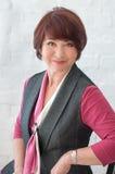 Donna di affari senior sorridente Fotografia Stock