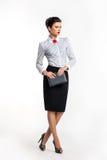 Donna di affari seria - modello di modo con il blocchetto per appunti Immagine Stock Libera da Diritti