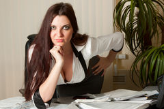 Donna di affari sexy sul lavoro immagine stock libera da diritti